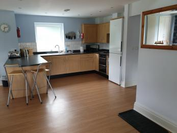 kitchen area, showing small section of worktop with a clear underspace at the end of the peninsula