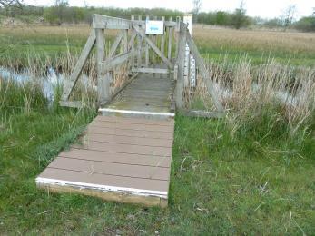 Meadow trail-bridge on longer route