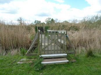 Meadow trail- bridge to riverbank (gate open in summer)