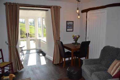 Mole's Cottage lounge showing main entrance