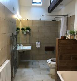 Accessible family bathroom/ wet room with non slip shallow bath