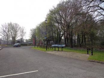Outdoor picnic and play area showing access from car park