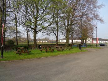 Outdoor picnic and play area showing tables