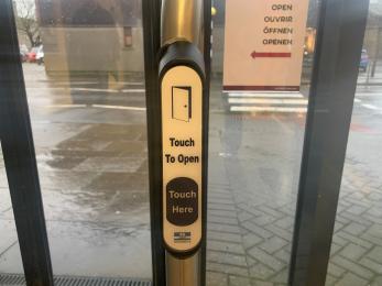 Push button on door.
