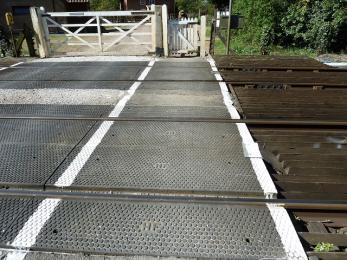 Railway crossing surface