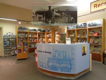 Reception and shop showing counter and shelves
