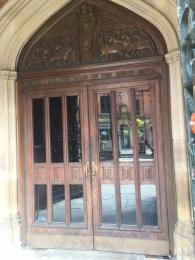 Image displaying the double wooden doors with glass panels to enter the Cathedral