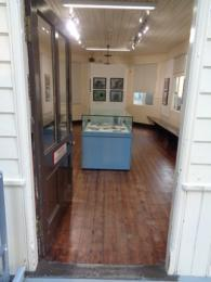 View showing doorway into exhibition area and display case beyond