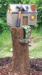 Photo of  sculpture in Fairy Village with bark surfacing.