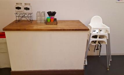 photograph of the water station and high chairs located in the additional seating area.
