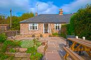 Croft bungalow private south facing garden - w/c friendly picnic table & bbq - sensory garden & open country views