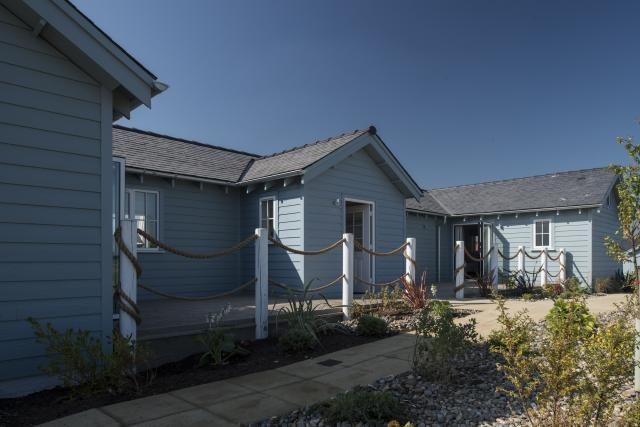 Marine themed one storey beach house with decking surrounds