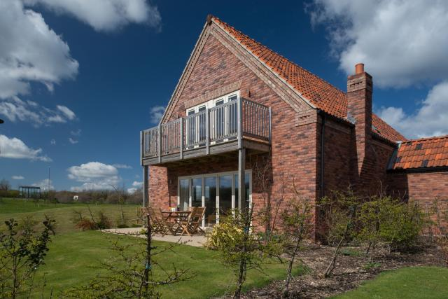 Red brick two storey detached villa