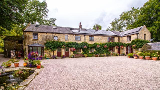 Underleigh House is an attractive converted cottage and shippon with parking on gravel immediately to the front of the property.