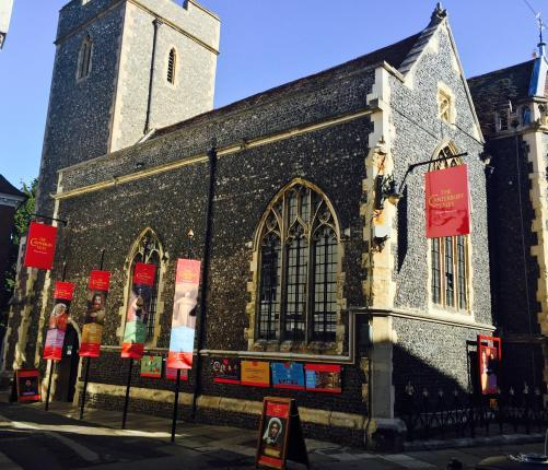 Exterior image of the attraction showing St Margaret's Church and our character flags along the entrance path.