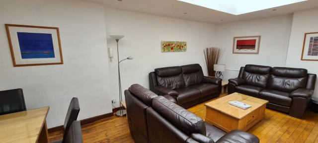 Brew House Living space with great art work and reclining leather sofas.