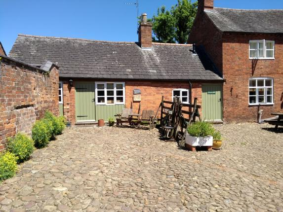 Entrance and parking spaces for cottage.  Cottage adjoining main farmhouse.