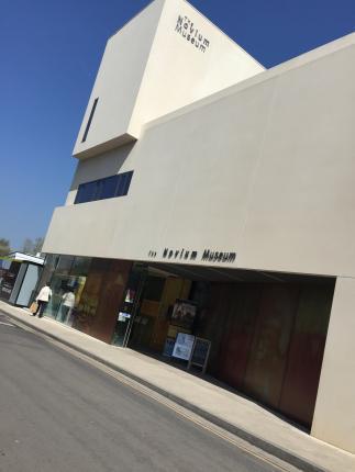 The Novium Museum RIBA award winning building against a clear blue sky