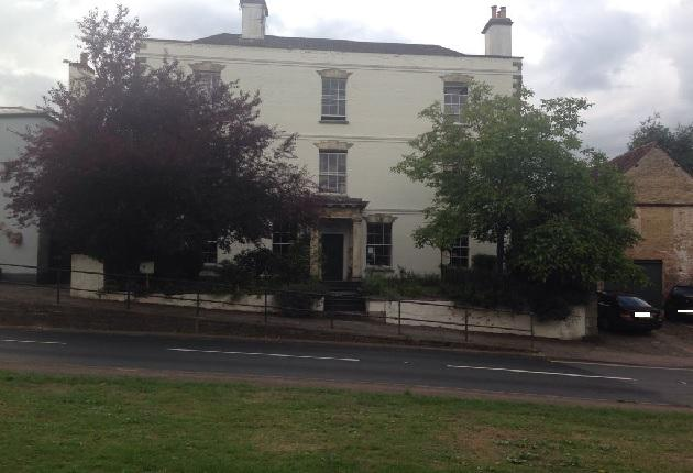 The Old House is on the main A48 through Newnham. It is set back from the pavement and has a drive for parking.