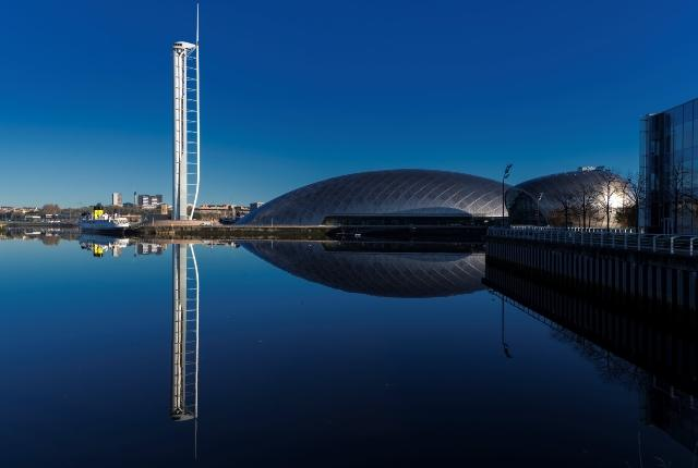 Glasgow Science Centre, Glasgow Tower and Cineworld IMAX buildings and reflection in the water of the River Clyde.